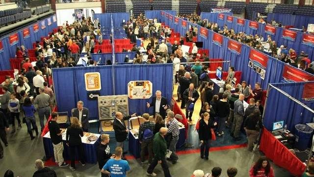 Visitors meet with Brookdale faculty and staff during the college's 2014 Fall Open House, held at the Collins Arena in Lincroft.