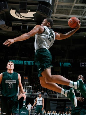 Michigan State's Miles Bridges goes up for a windmill