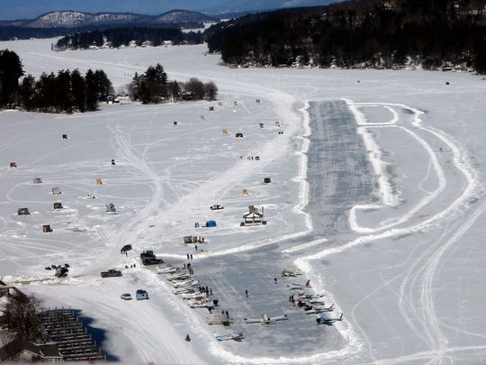 Planes park after flying in on frozen Lake Winnipesaukee
