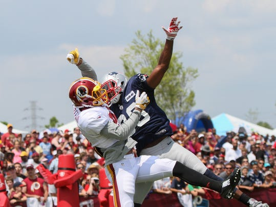 New England Patriots Brandon Browner, right,. breaks up a pass to Washington Redskins Cody Hoffman during an NFL Football training camp scrimmage between tje New England Patriots and  Washington Redskins in Richmond, Va., Tuesday, Aug. 5, 2014.   (AP Photo/Skip Rowland)