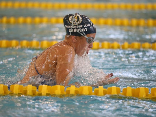 Makayla Sargent, 18, of Victor, swims laps during one of her daily training sessions with the Victor Swim Club at the Victor Aquatic Center Monday, June 20, 2016.  Makayla is competing in the Olympic Trials in Nebraska at the end of June.