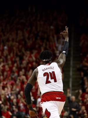 Montrezl Harrell hit a 3-pointer that pushed U of L in front of No. 2 Virginia 43-40 on Saturday night.