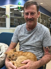 Thomas Jr., or T2, sits with his owner, Perry Martin, of Fort Pierce, after being reunited after 14 years at the Humane Society of the Treasure Coast.