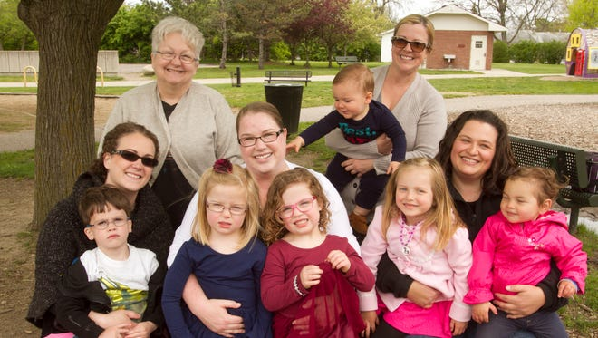 Candace Streng, seated at center in this photo taken Thursday, May 11, 2017, is surrounded by moms who helped fund her cancer treatments by organizing a GoFundMe page and June 17 fundraiser. Seated from left are Caryn Walker holding 4-year-old son Weston, Candace holding twins Emily and Sarah Kovalik, Kara Scott holding 4 1/2-year-old Lila and 2-year-old Hannah Scott. Standing, from left are Caryn Walker's mom Sheryll Sharbowski and Sarah Bees, holding 1-year-old son Henry Bees.