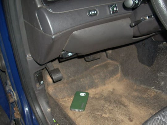 Authorities located a phone on the floor of a patrol car driven by Deputy Harold Robinson.