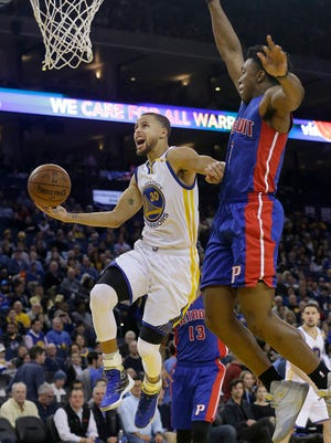 Warriors guard Stephen Curry shoots against Pistons forward Stanley Johnson during the second half in Oakland, Calif., Thursday, Jan. 12, 2017.