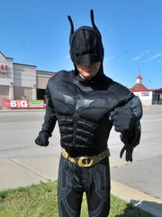 Aaron Vangarde, 27, of Wausau, poses for a photo Monday in a Batman costume as part of his job at the Little Caesars Pizza on Stewart Avenue in Wausau.