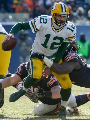 Green Bay Packers quarterback Aaron Rodgers is sacked during the second quarter against the Chicago Bears at Soldier Field.