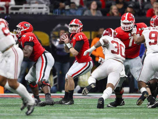 Georgia quarterback Jake Fromm looks to throw against