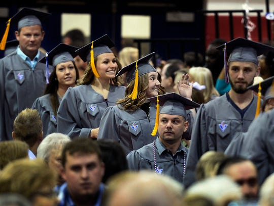 Breanna Burchett, center, waves to family members as she walks into the commencement ceremony at Volunteer State Community College on May 6, 2017. Burchett was one of the first Tennessee Promise students to graduate from college.