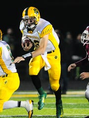 Ashwaubenon quarterback James Morgan on the run against De Pere in the WIAA Level 1 playoff game at Goelz Field in Ashwaubenon, Friday, October 24, 2014.