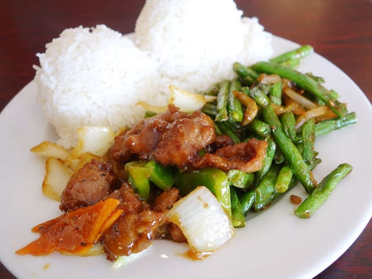 Black pepper beef (left) and stir-fried green beans (right) at Miu's Bistro
