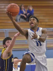 Driving to the rim Tuesday is Salem's Freddie McGee