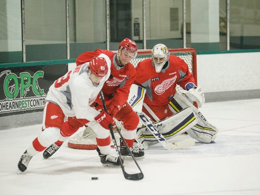 Forward Dominik Shine, from left, is defended by forward