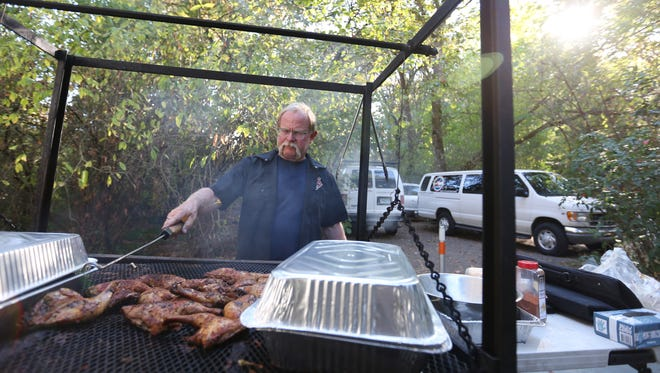 Mike Adams, owner of Adam's Rib Smoke House, serves up barbecue meats during the Blues, Brews and Barbecue event on Sunday, Sept. 27, 2015, at the Historic Deepwood Estate in Salem.                                                                                                                                                                            Mike Adams, owner of Adam's Rib Smoke House serves up barbecue meats during the Blues, Brews and Barbecue event on Sunday, Sept. 27, 2015, at the Historic Deepwood Estate in Salem.
