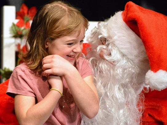 Kaylee Blosser of Waynesboro spends a moment with Santa