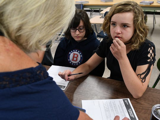 Carter high student Sydney Parman listens to her teacher Cynthia Cupp while work on assignment in AP Human Geography class Wednesday, Aug. 23, 2017. More students took and passed AP tests in Tennessee than ever before last school year.