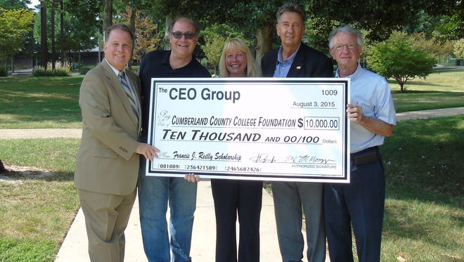 (From left) Lou Magazzu, executive director of The CEO Group; John Mangel, treasurer; Sue Perry, executive director of the Cumberland County College Foundation; Art Ogren Jr., president of The CEO Group; and Dennis DiLazzero, vice chairman of the college foundation.