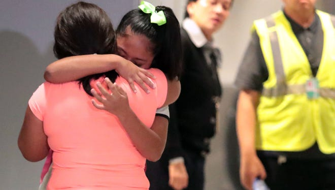 Yoselin Yamileth Velasquez Alemengor, 12, cries as she reunites with her mother, Perla Karlili Alemengor Miranda De Velasquez, at the Los Angeles International Airport on July 1, 2018. They were separated at the border in San Luis, Arizona, a month ago.