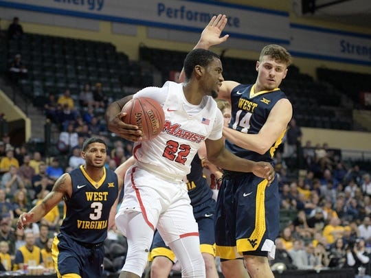 Marist guard Austin Williams (22) grabs a rebound in front of West Virginia guard James Bolden (3) and guard Chase Harler (14) during the first half of an NCAA college basketball game at the AdvoCare Invitational tournament Thursday, Nov. 23, 2017, in Lake Buena Vista, Fla. (AP Photo/Phelan M. Ebenhack)