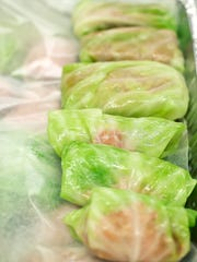 Stuffed cabbage rolls are ready for the oven.