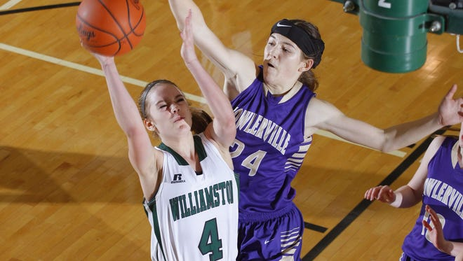 Fowlerville's  Elie Smith (right) had a monster double-double in her team's opening night win over Lansing Sexton.