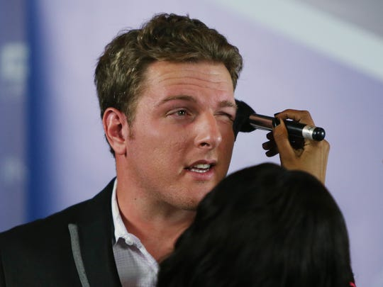 Colts punter Pat McAfee gets a makeup touchup from Sparkle Myers, from MakeUp by Sparkle, during the Pat McAfee Show at Kilroy's Downtown Nov. 19.