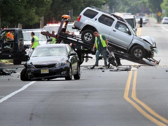 The vehicles involved in a fatal collision on Whitesville Road in Toms River are removed from the scene Thursday, July 14, 2016.