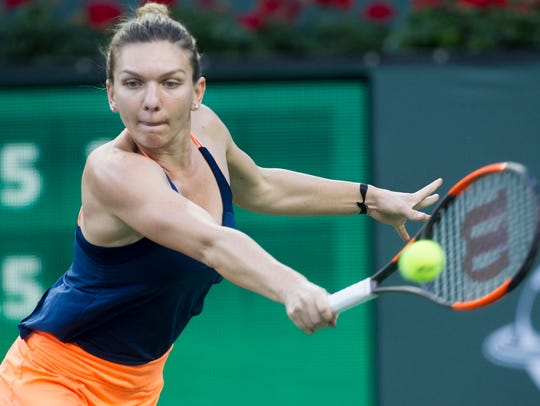 Simona Halep of Romania beats Croatian  Donna Vekic
