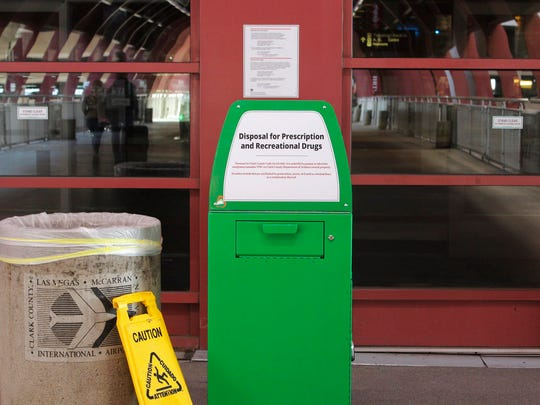 """A metal container designed for """"Disposal for Prescription and Recreational Drugs,"""" sits outside one of the entrances to McCarran International Airport in Las Vegas, Thursday, Feb. 22, 2018."""