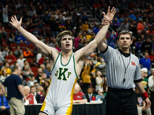 Ben Sarasin of Cedar Rapids, Kennedy celebrates a 9-5 victory over Anthony Zach of Waukee during their class 3A 170 pound championship match at Wells Fargo Arena on Saturday, Feb. 17, 2018, in Des Moines.