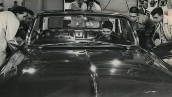 A car enthusiast gets behind the wheel of a new Oldsmobile at the Milwaukee Auto Show on Oct. 14, 1961. This photo was published in the Oct. 15, 1961, Milwaukee Journal.