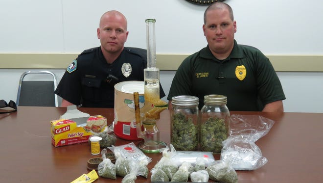 Greenbrier Police pose with recovered drugs and drug paraphernalia taken after an attempted home invasion Sunday.