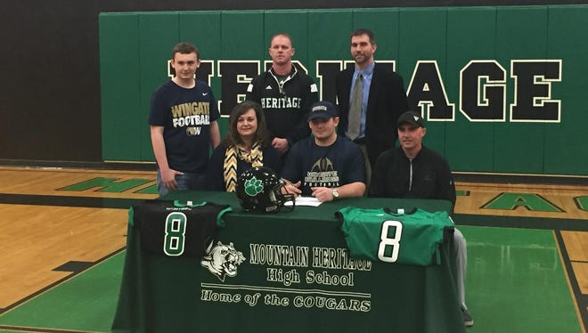 Mountain Heritage senior Isaac Allen has signed to play college football for Wingate.
