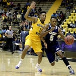 Jackson State guard Paris Collins (5) leads the Tigers in scoring at 15.4 points per game.