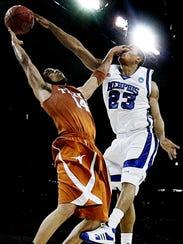 March 30, 2008 - Memphis' Derrick Rose, right, blocks