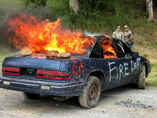 Flames shoot from a Buick Regal that was set on fire Wednesday as part of a training exercise for local fire investigators at the Shasta College Fire Training Grounds.