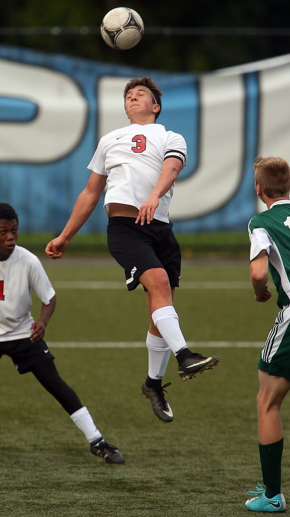 Crosspoint's Aydan Laurion (3) connects with a header