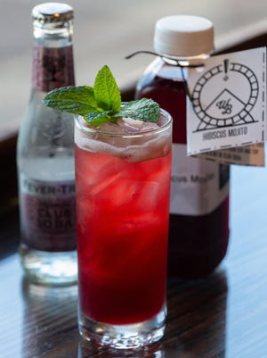 This hibiscus mojito is a mixed cocktail served to-go.