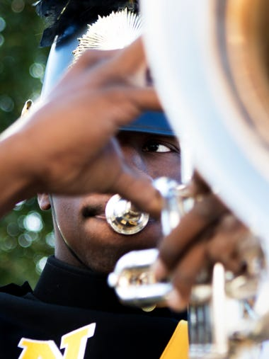 Brandon Whitfield, 17, plays the baritone as he warms