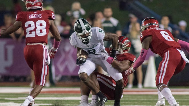 Oct 1, 2016; Bloomington, IN, USA;  Michigan State Spartans wide receiver Donnie Corley (9) catches the ball and is tackled by Indiana Hoosiers defensive back Tony Fields (19) in the second quarter of the game at Memorial Stadium. Mandatory Credit: Trevor Ruszkowski-USA TODAY Sports