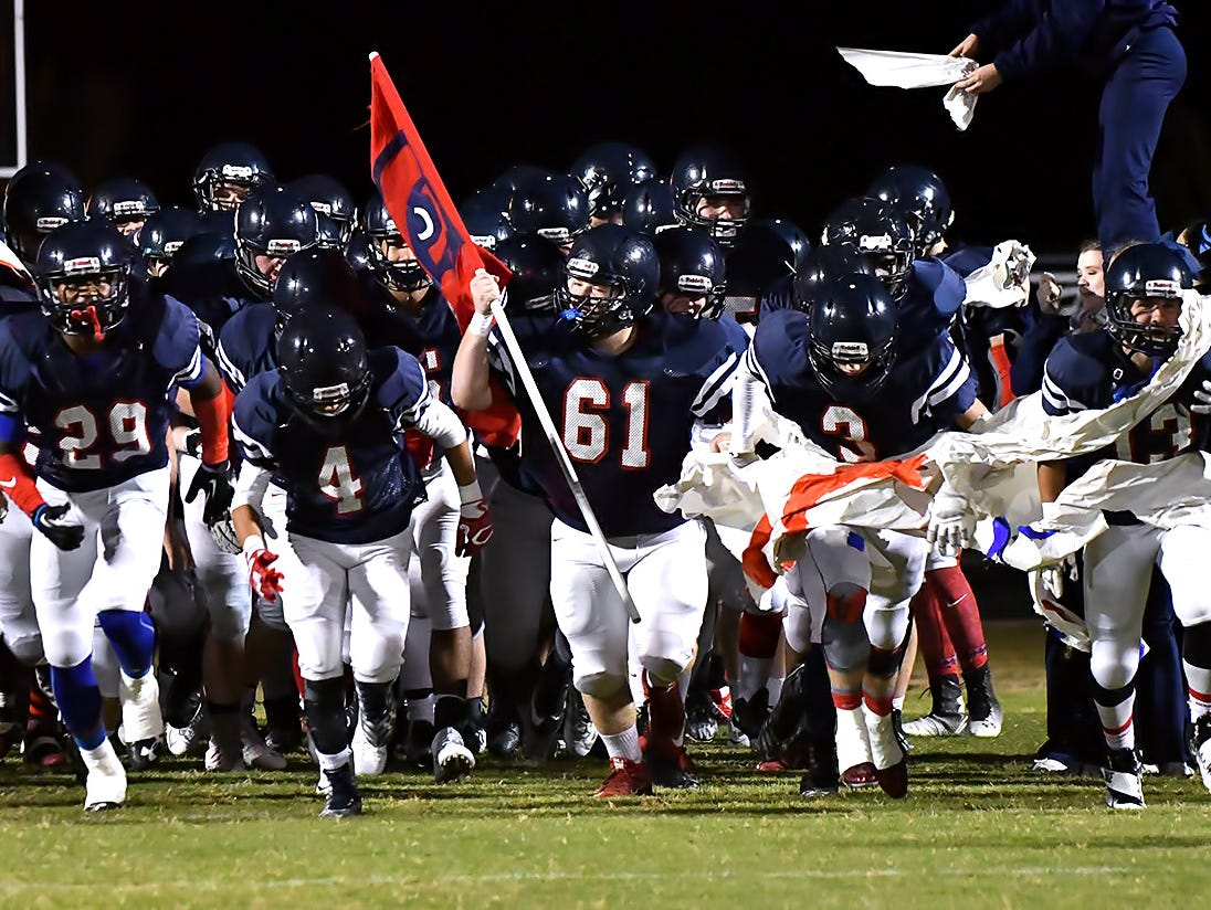 Creek Wood charges onto the field against Hillwood.
