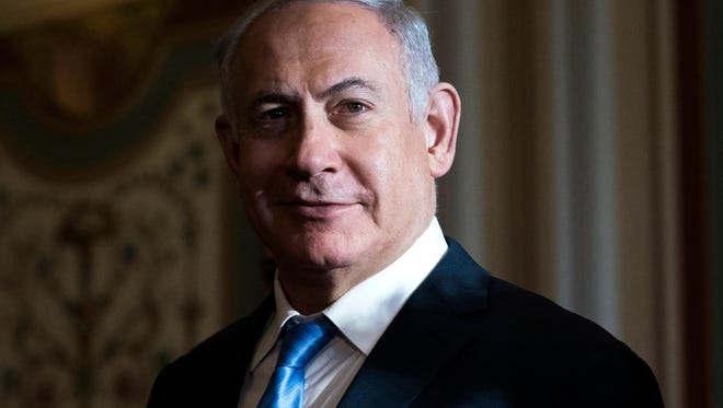 Israeli Prime Minister Benjamin Netanyahu walks to a meeting with members of the Senate Foreign Relations Committee in the U.S. Capitol in Washington, D.C., on March 6, 2018.