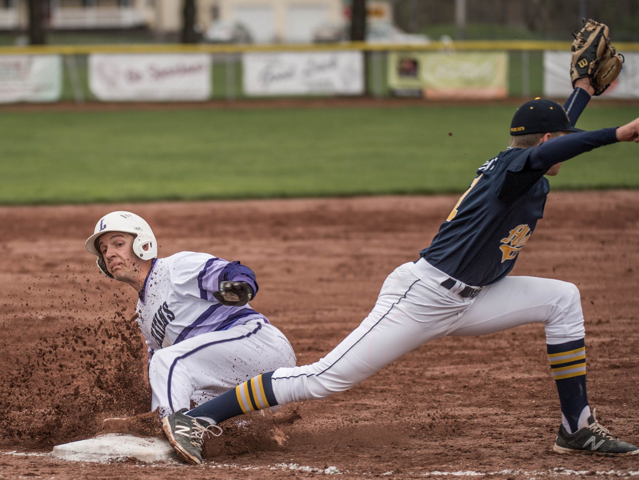 Lakeview senior Nick Jones slides into third during a recent game. The Spartans are undefeated and ranked No. 5 in the state.