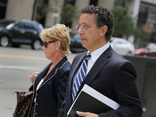 Al Iacobelli, former Fiat Chrysler labor chief, right, walks out of the federal courthouse in Detroit on Tuesday, August 1, 2017, with an unidentified woman.