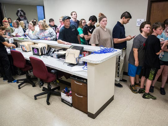 A crowd of potential pet adopters packs into the entrance
