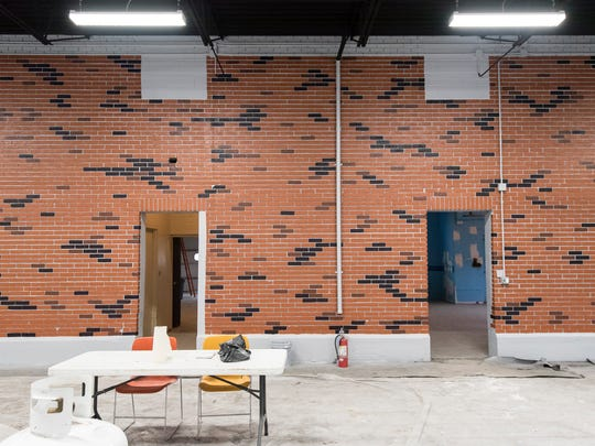 The original brickwork on the wall in the bay of the Marysville Community Center received new paint as part of its renovations.