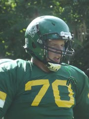 Coleman senior Donovan Salewski looks on during a drill at practice on Aug. 8. Salewski is a four-year varsity player and one of several players on the Coleman roster that are at least 6-foot-2.