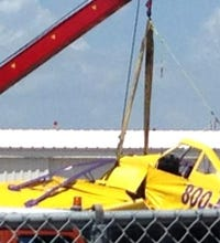 Plane towed to shore after deadly crash