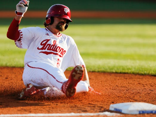 Luke Miller of the Indiana Hoosiers slides into third